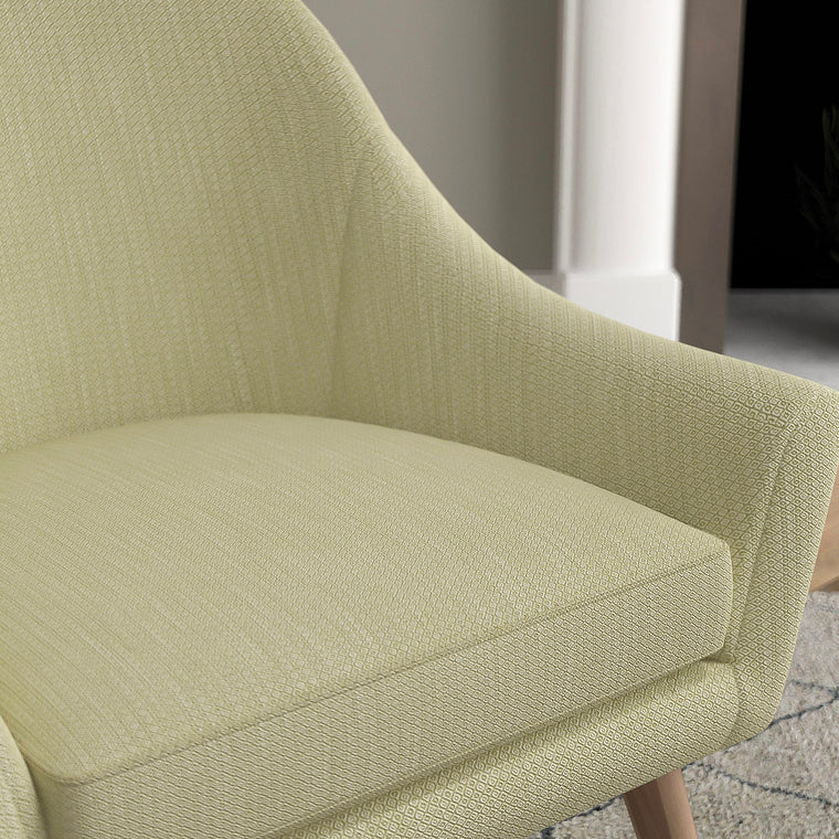 Chair with a pistachio green and neutral upholstery fabric with a small diamond weave fabric