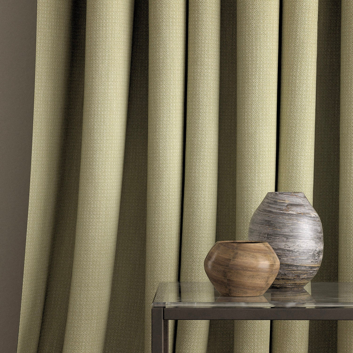 Curtain in a pistachio green and neutral weave fabric with a small diamond design and a stain resistant finish