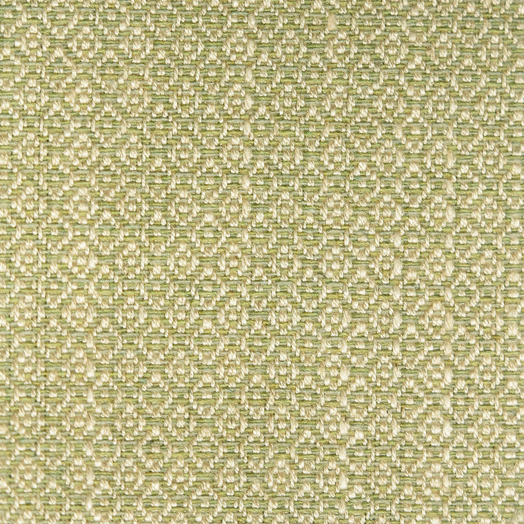 Fabric sample of a pistachio green and neutral weave fabric with a small diamond design and stain resistant finish for curtains and upholstery