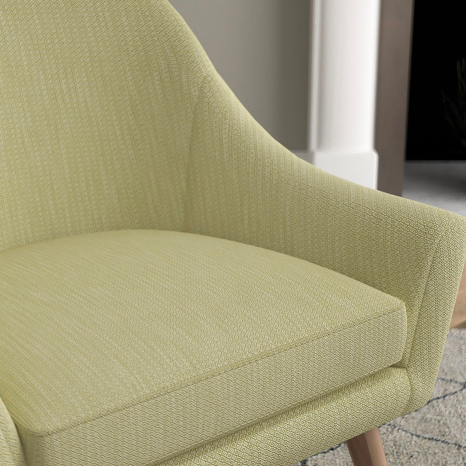 Chair with a pear green and neutral upholstery fabric with a small diamond weave fabric