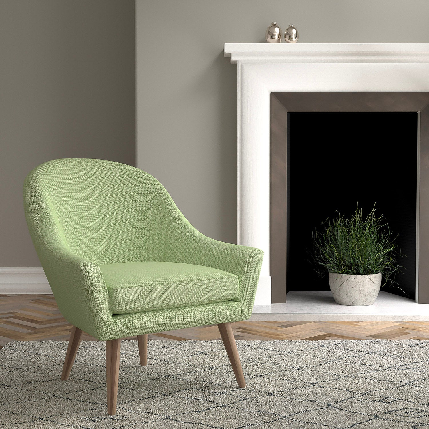 Chair in a green and neutral upholstery fabric with a small diamond design and a stain resistant finish