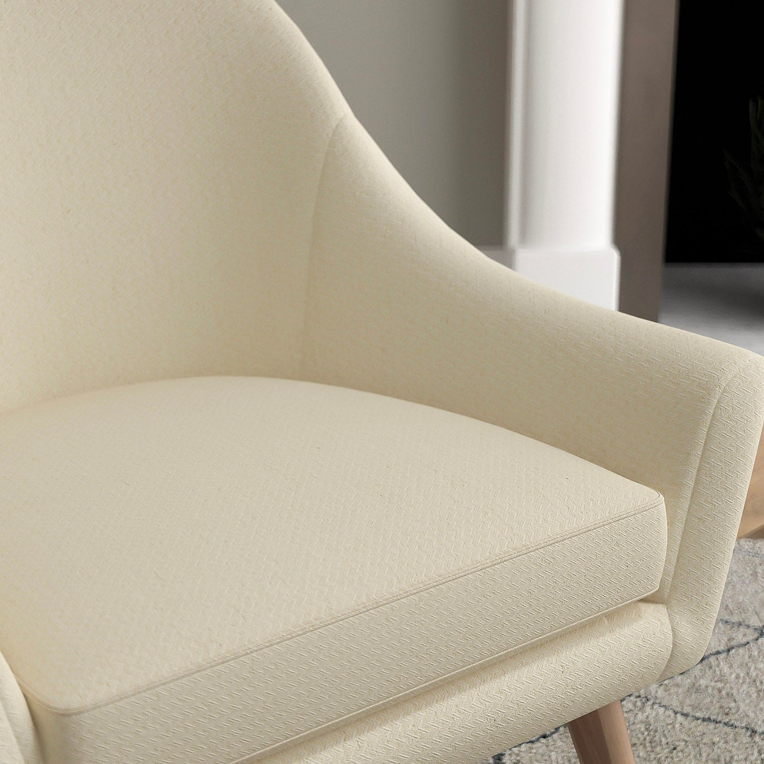 Chair with a light neutral upholstery fabric with a chevron weave fabric