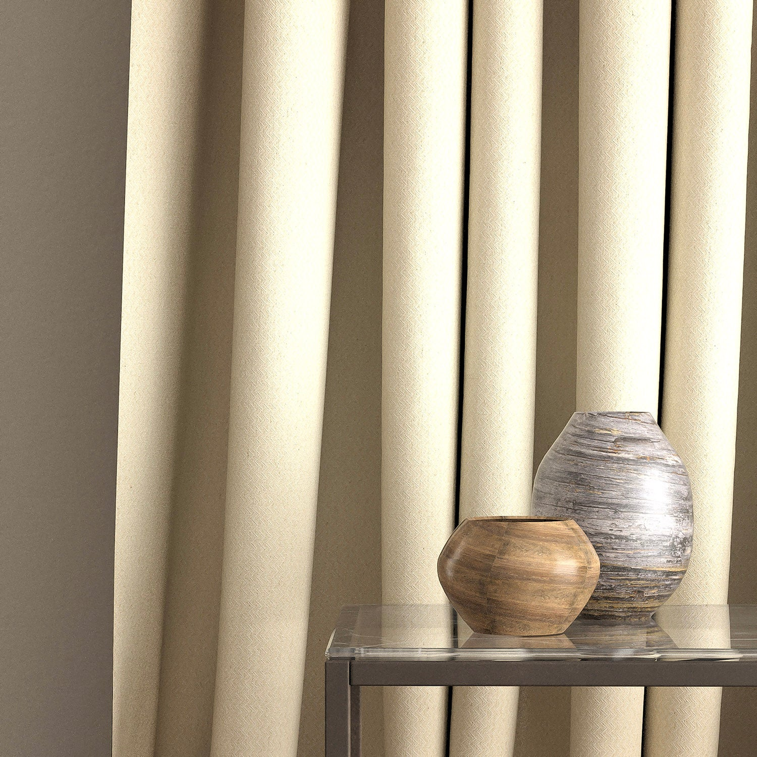 Curtain in a light neutral zig zag weave fabric with a stain resistant finish