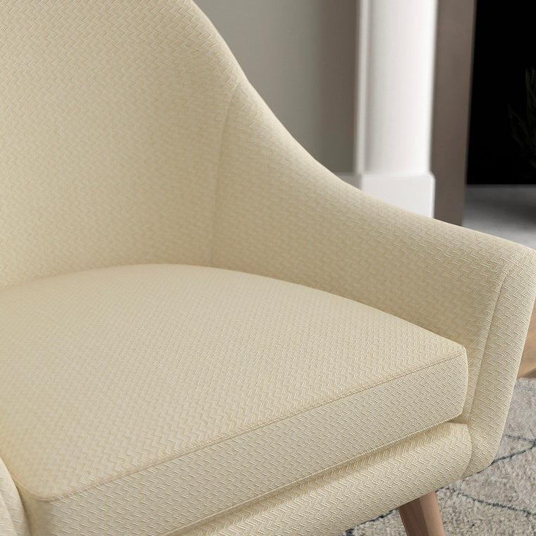 Chair with a neutral upholstery fabric with a chevron weave fabric