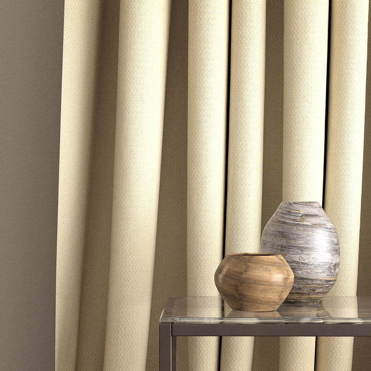 Curtain in a neutral zig zag weave fabric with a stain resistant finish