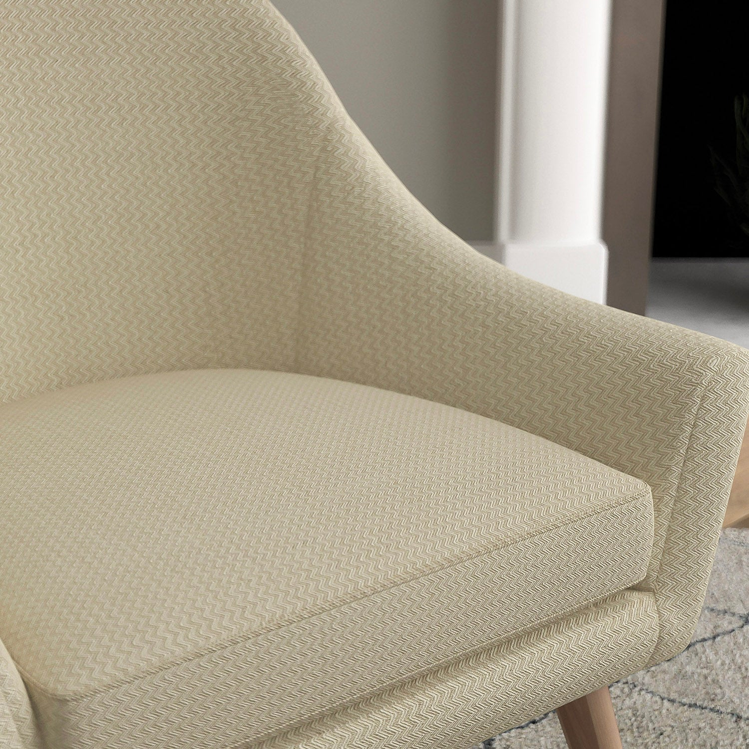 Chair with a oatmeal and neutral upholstery fabric with a chevron weave fabric