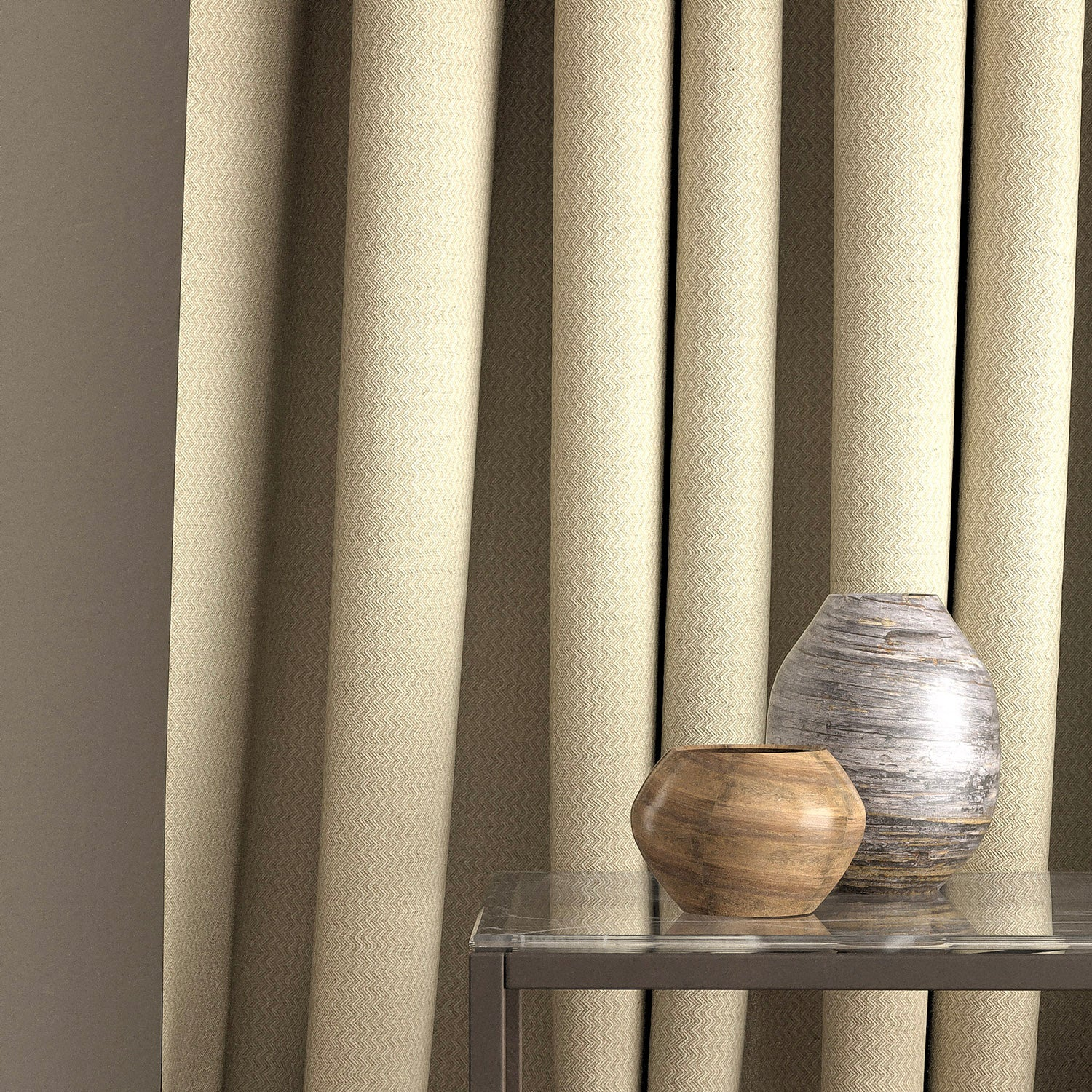 Curtain in a oatmeal and neutral zig zag weave fabric with a stain resistant finish
