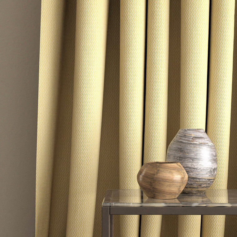 Curtain in a bright yellow and neutral zig zag weave fabric with a stain resistant finish
