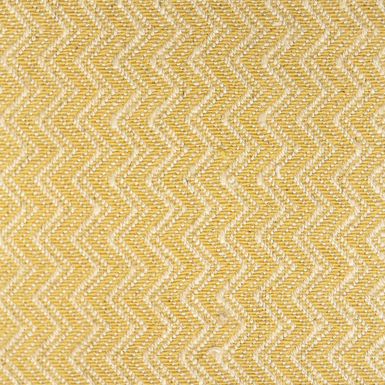 Bright yellow and neutral chevron weave fabric with a stain resistant finish for curtains and upholstery