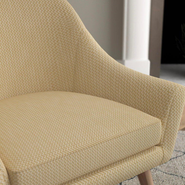 Chair with a yellow and neutral upholstery fabric with a chevron weave fabric