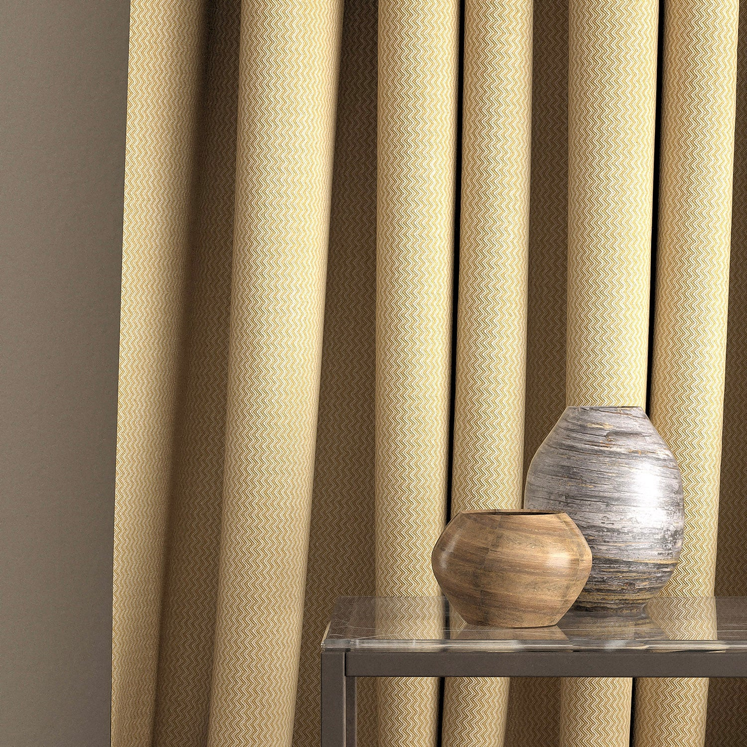 Curtain in a yellow and neutral zig zag weave fabric with a stain resistant finish