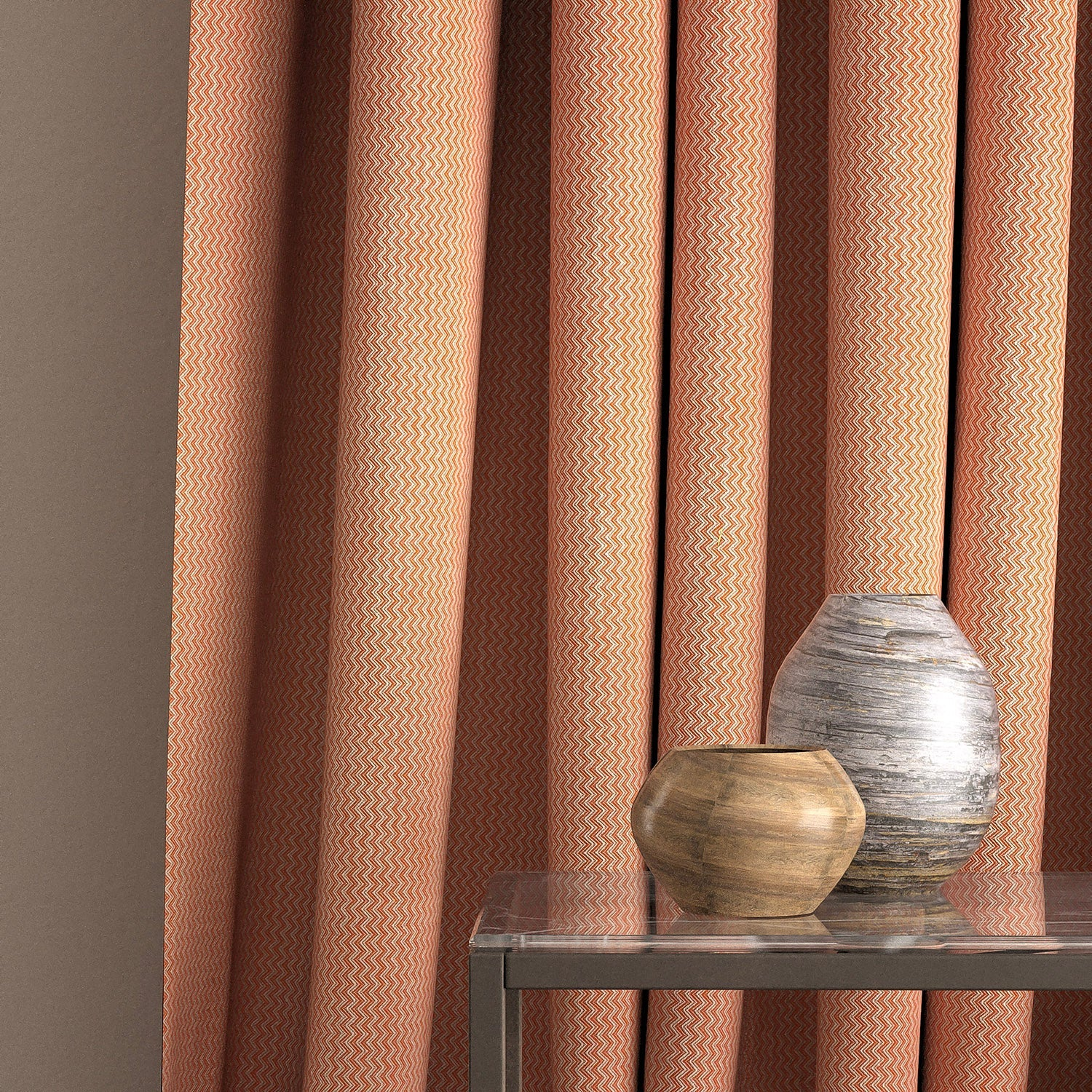 Curtain in a orange and neutral zig zag weave fabric with a stain resistant finish