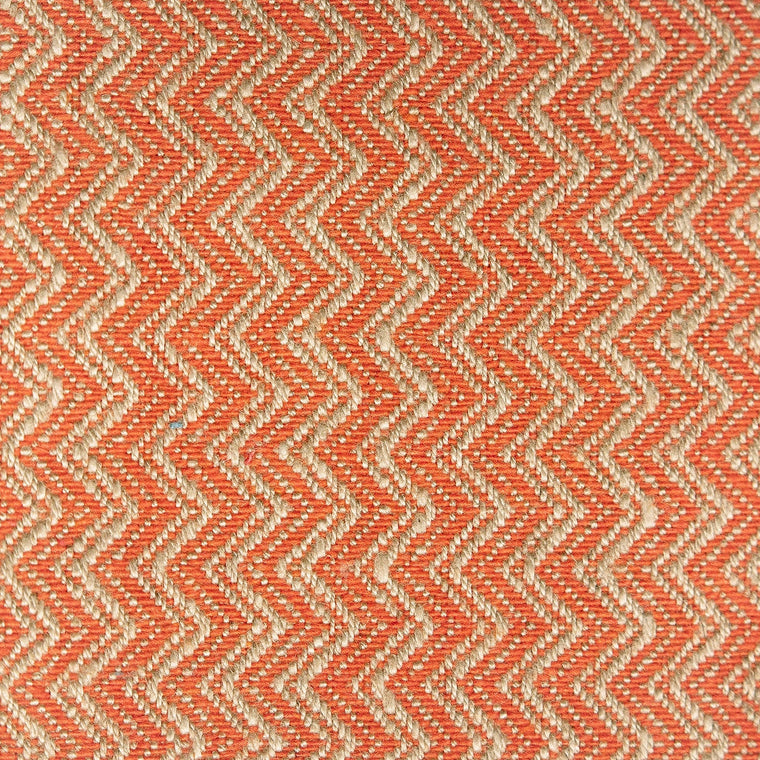 Orange and neutral chevron weave fabric with a stain resistant finish for curtains and upholstery