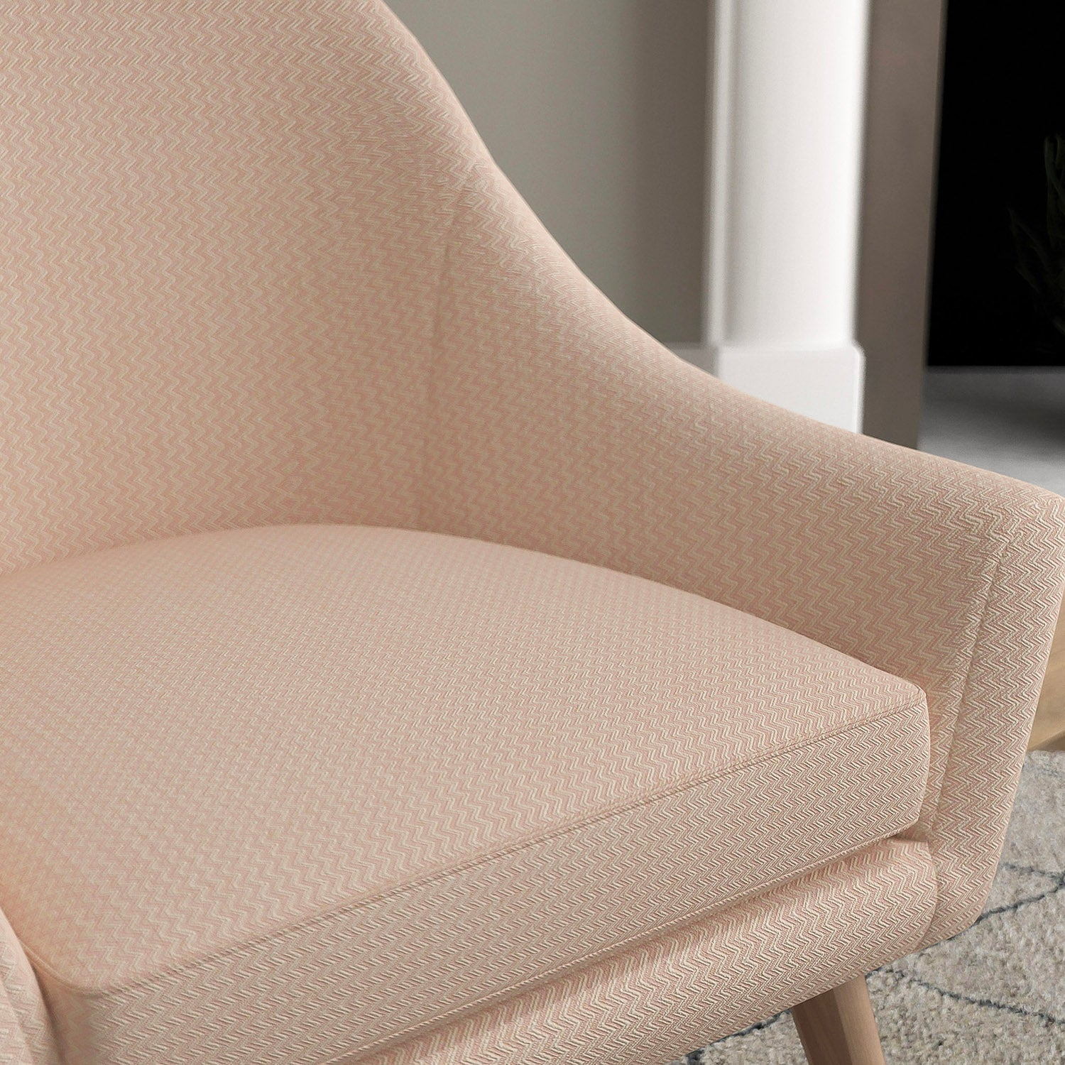 Chair in a pink upholstery fabric with chevron weave design and stain resistant finish