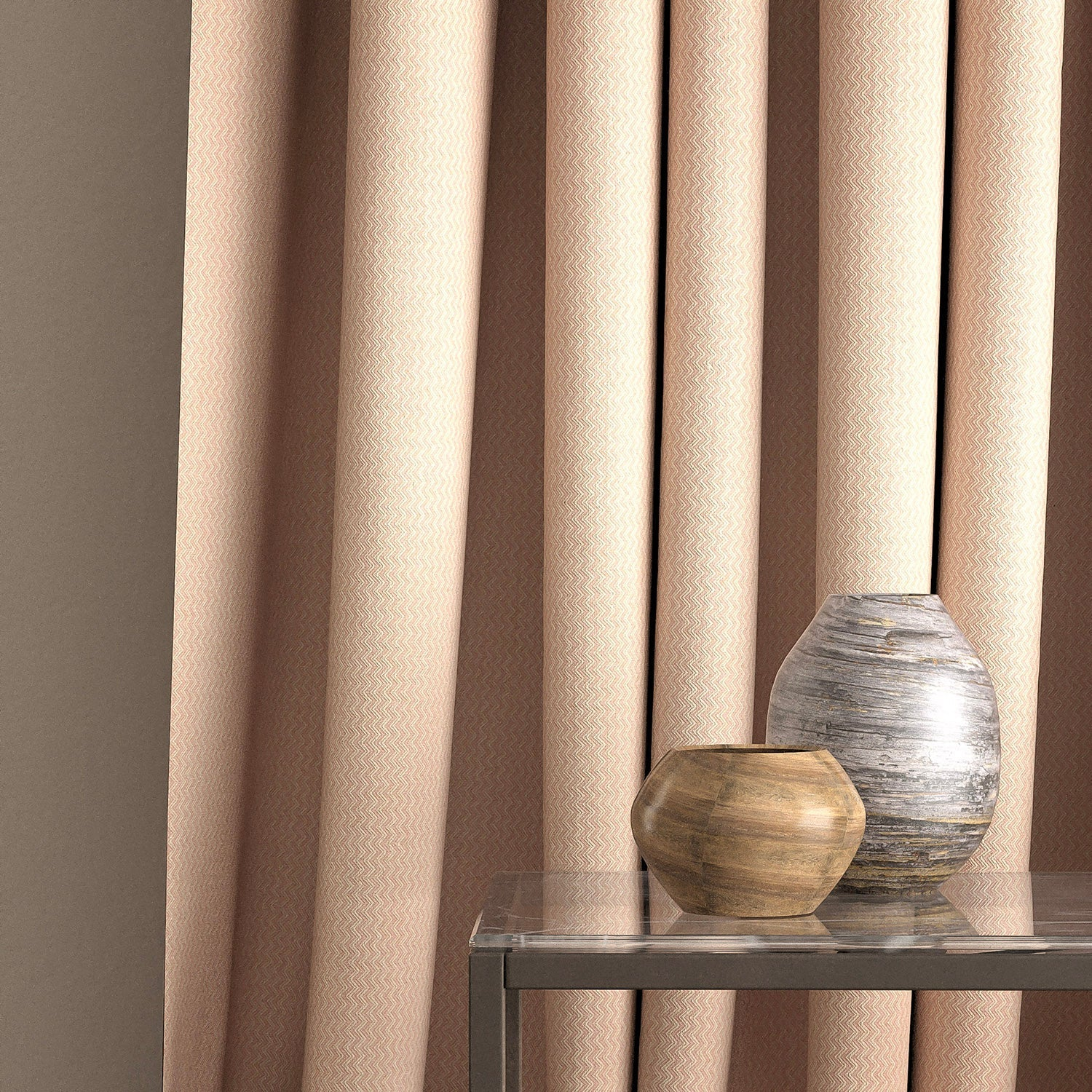 Curtain in a light pink furnishing fabric with zig zag weave design