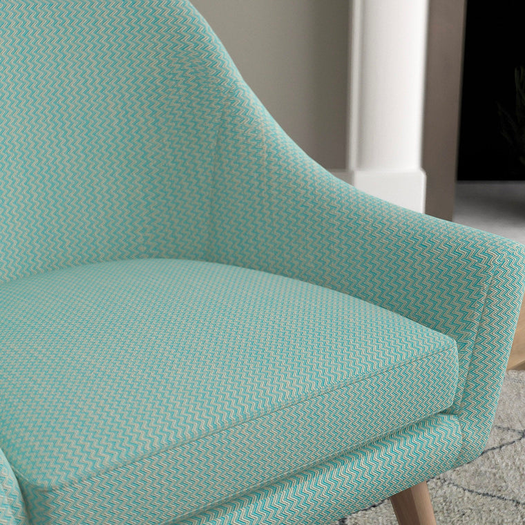 Chair in a turquoise upholstery fabric with zig zig weave design and stain resistant finish