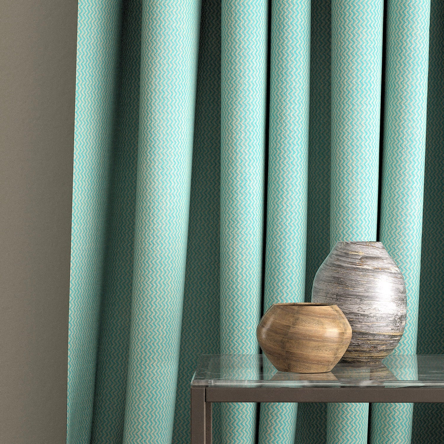 Curtain in a turquoise zig zag fabric with a stain resistant finish