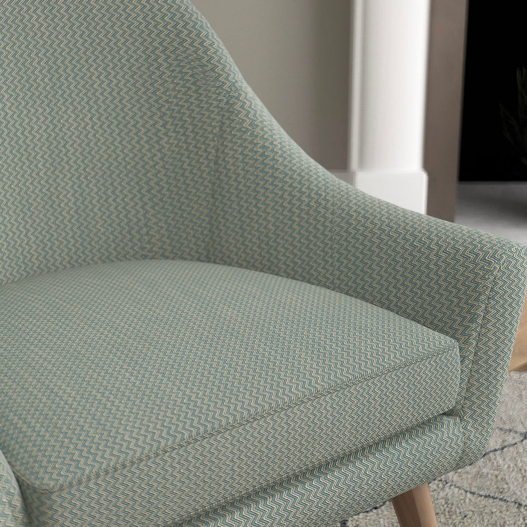 Chair in a blue chevron weave upholstery fabric with stain resistant finish