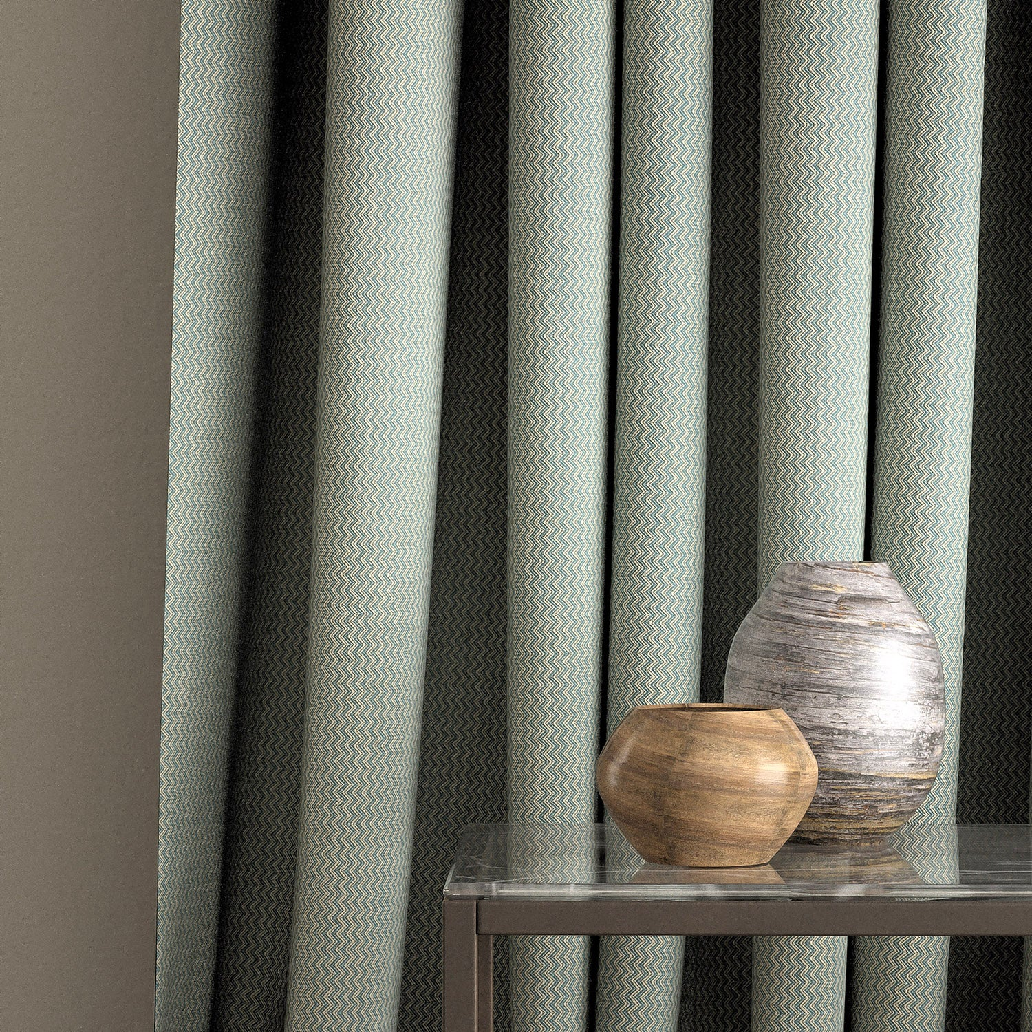 Curtain in a blue zig zag weave fabric with a stain resistant finish