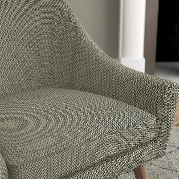 Chair in a dark grey upholstery fabric with zig zag design and stain resistant finish