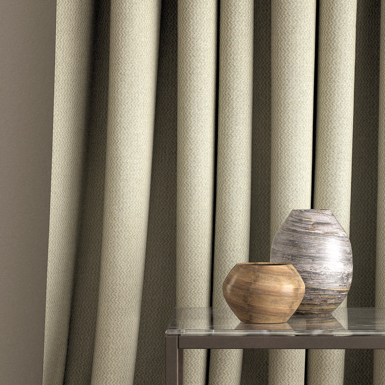 Curtain in a blue grey fabric with a chevron design and a stain resistant finish
