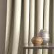Curtain in a grey fabric with chevron design