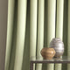 Curtain in a mint green fabric with zig zag design and stain resistant finish