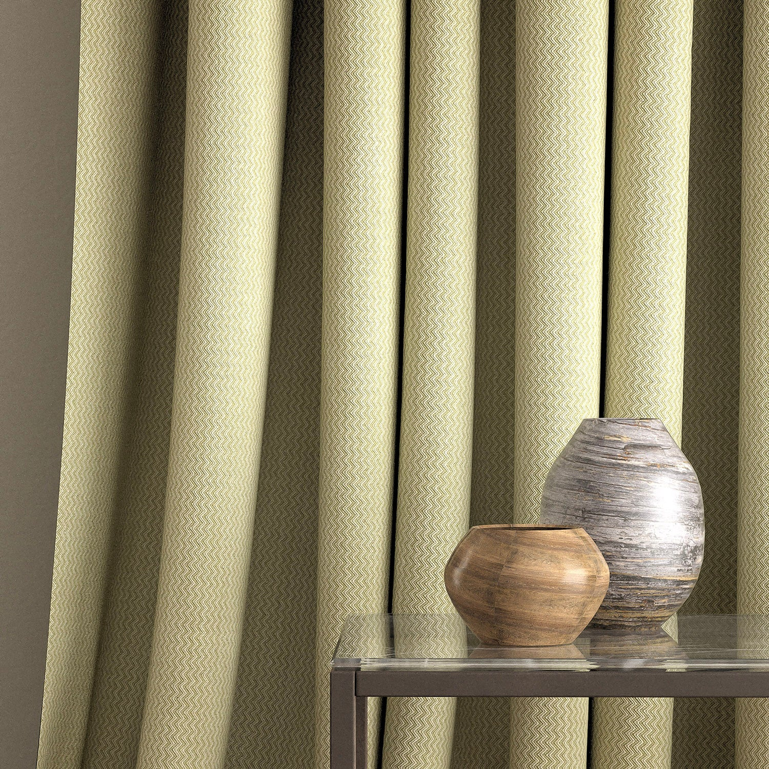 Curtain in a green fabric with chevron weave design and stain resistant finish