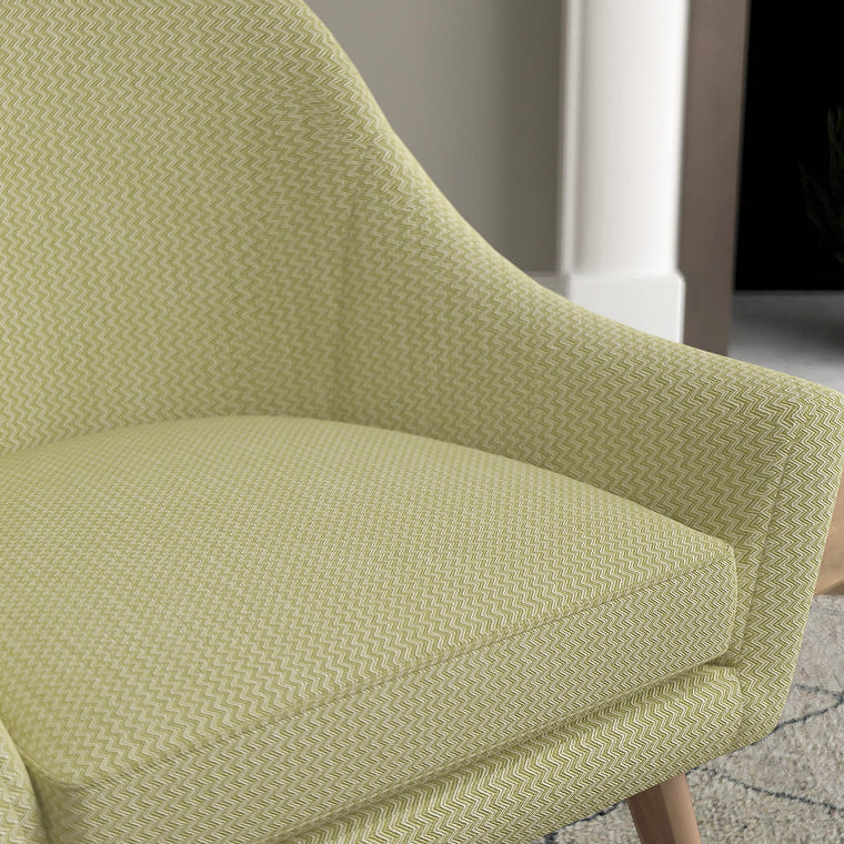 Chair in a green upholstery fabric for contract and domestic use with a zig zag weave