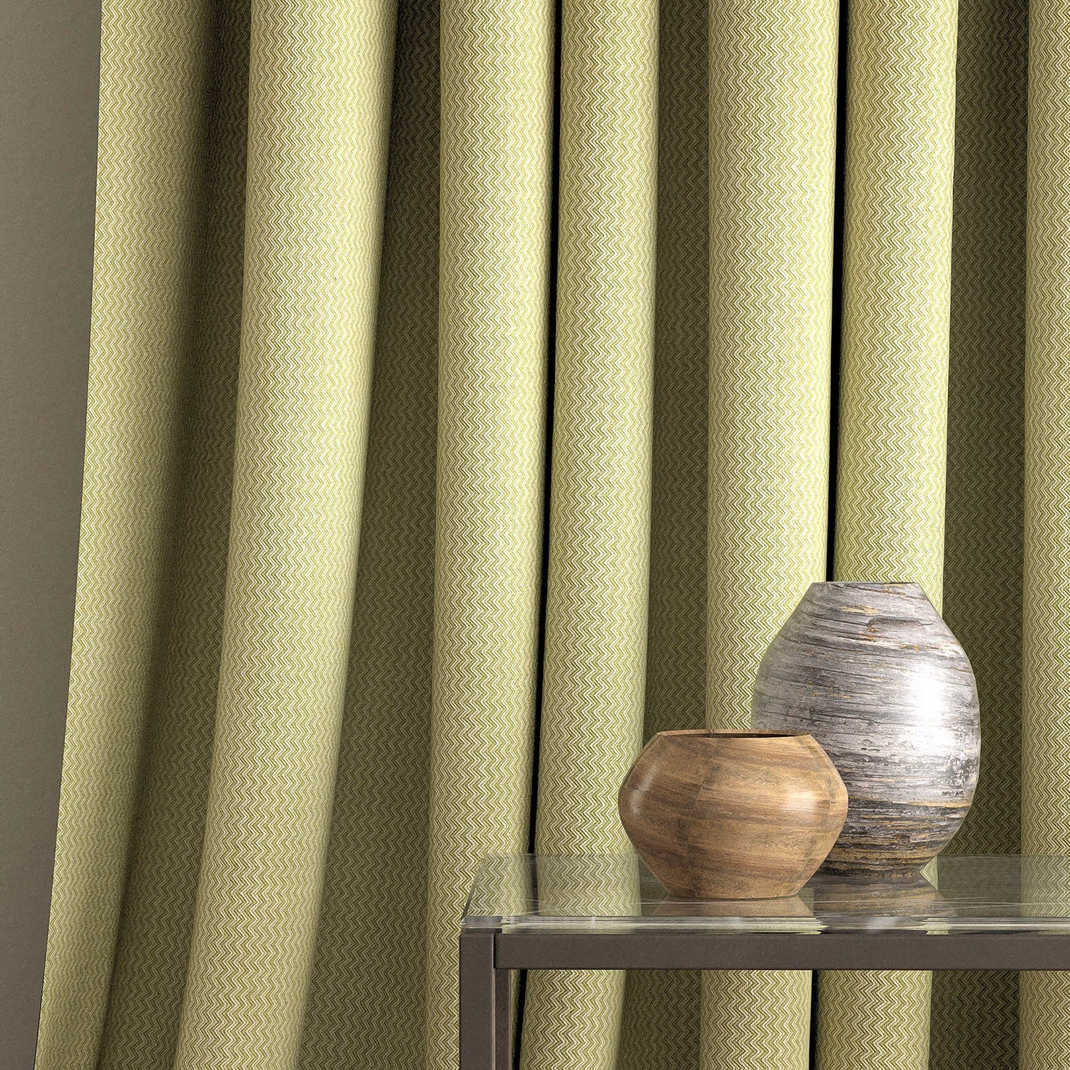 Curtain in a green fabric with chevron weave and stain resistant finish