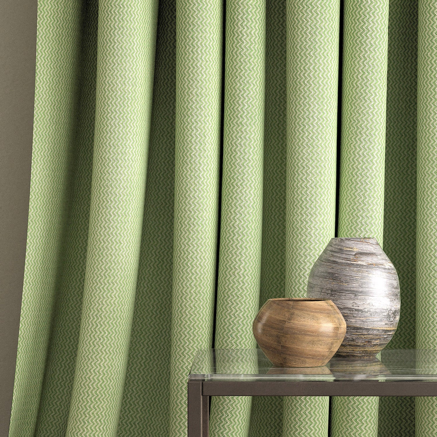 Curtain in a green fabric with zig zag weave and stain resistant finish