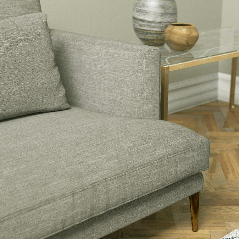 Sofa upholstered in a light grey plain linen blend fabric