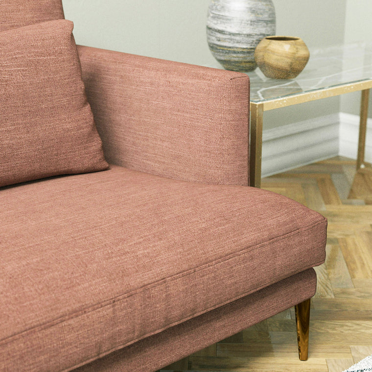 Sofa upholstered in a blush pink linen blend fabric