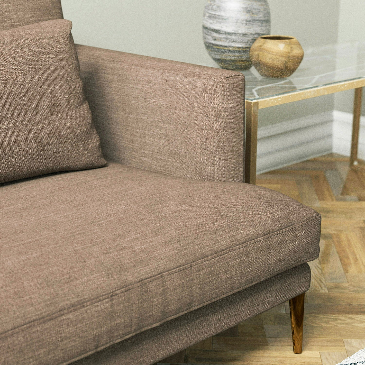 Sofa upholstered in a mink coloured linen blend fabric