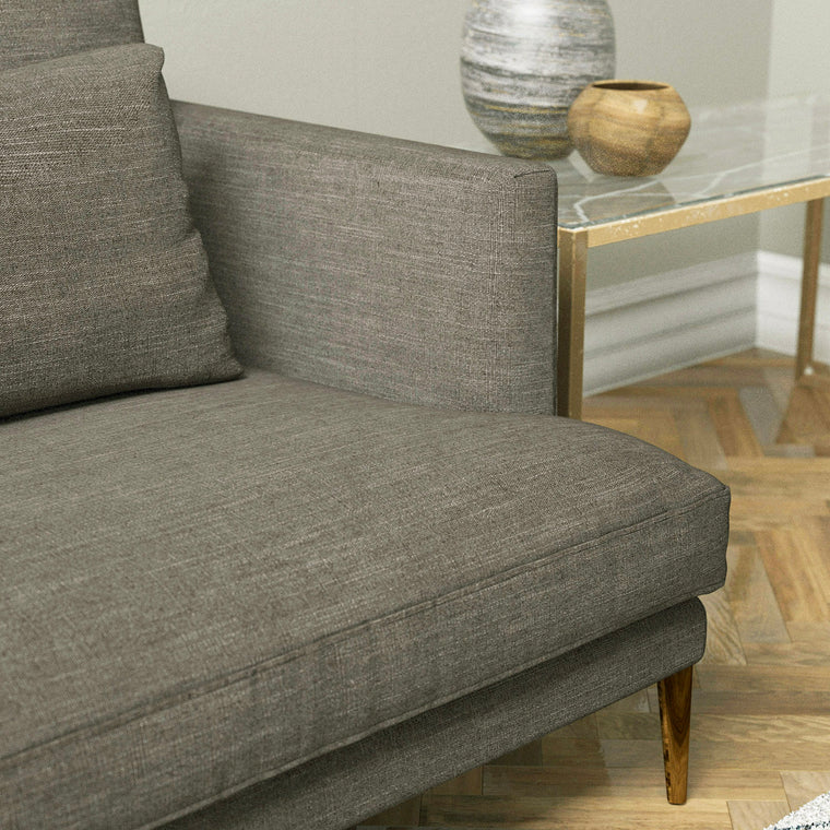 Sofa upholstered in a rustic brown linen blend fabric, suitable for contact and domestic use