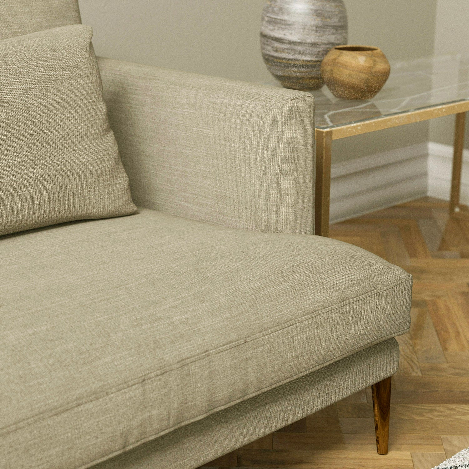 Sofa upholstered in a linen coloured plain linen blend fabric