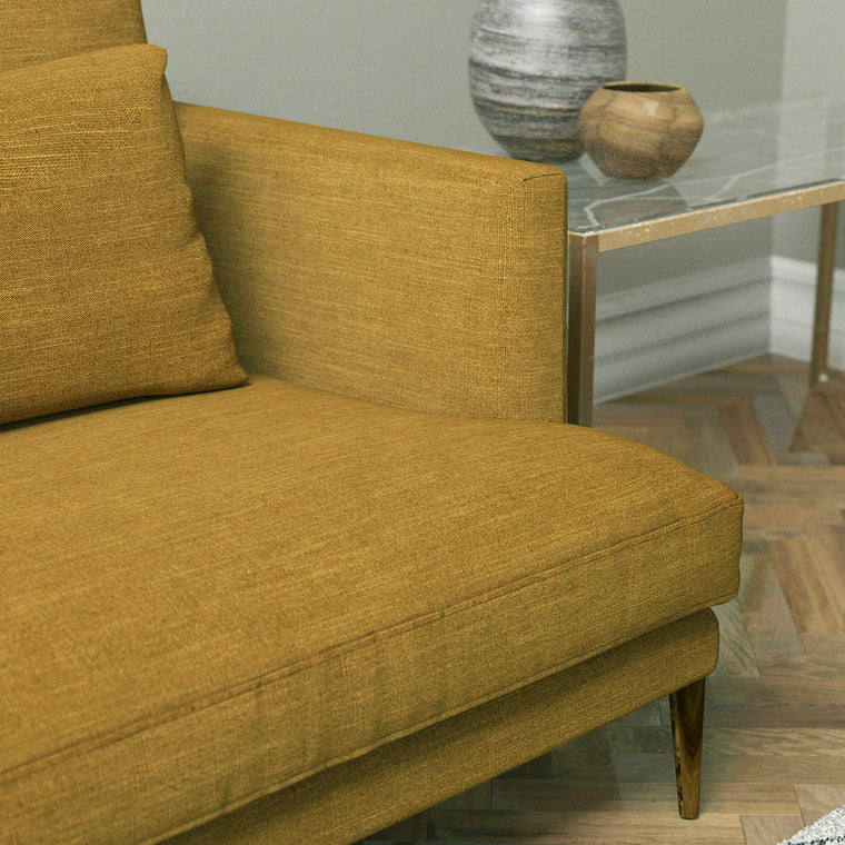 Sofa upholstered in a ochre yellow linen mix fabric