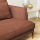 Sofa upholstered in a terracotta linen blend fabric