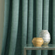 Curtain in a teal linen mix fabric