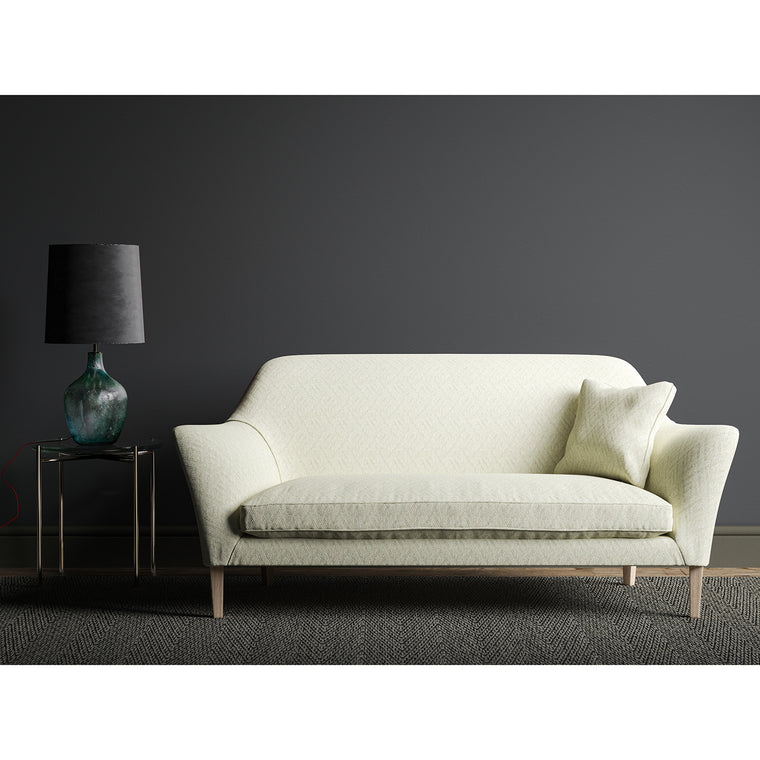 Sofa in a off white geometric weave fabric