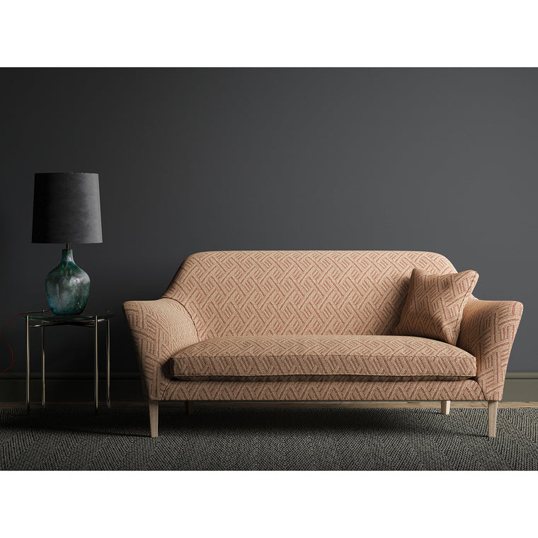 Sofa in a red and neutral geometric weave fabric