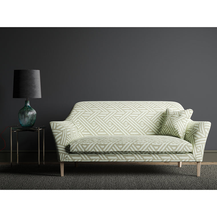 Sofa upholstered in a grey and white print fabric with a large scale geometric design