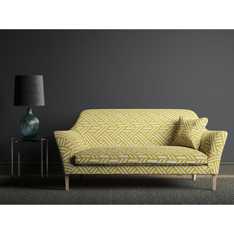Sofa upholstered in a yellow and white large scale geometric print