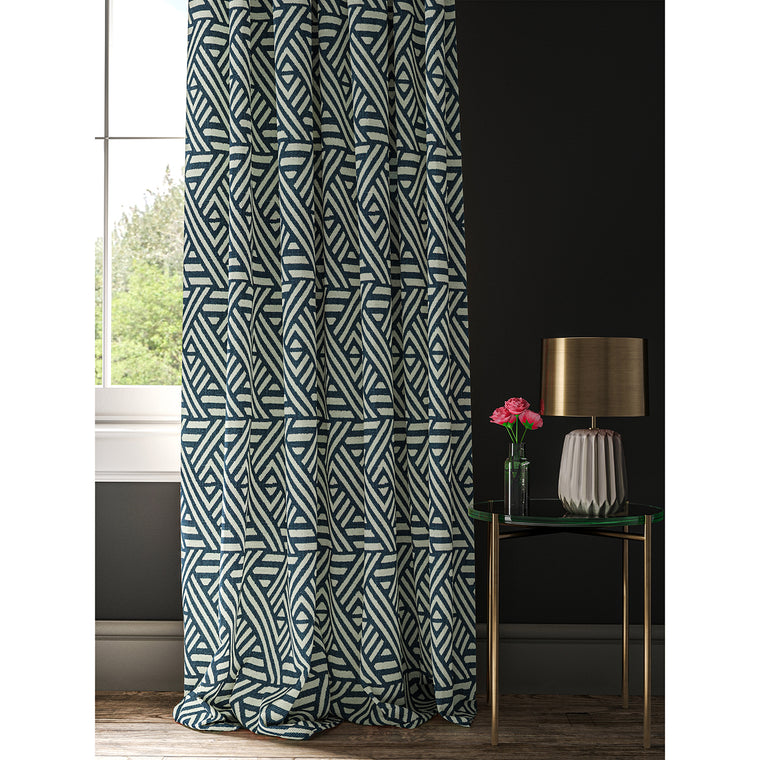 Curtain with a blue and white geometric print