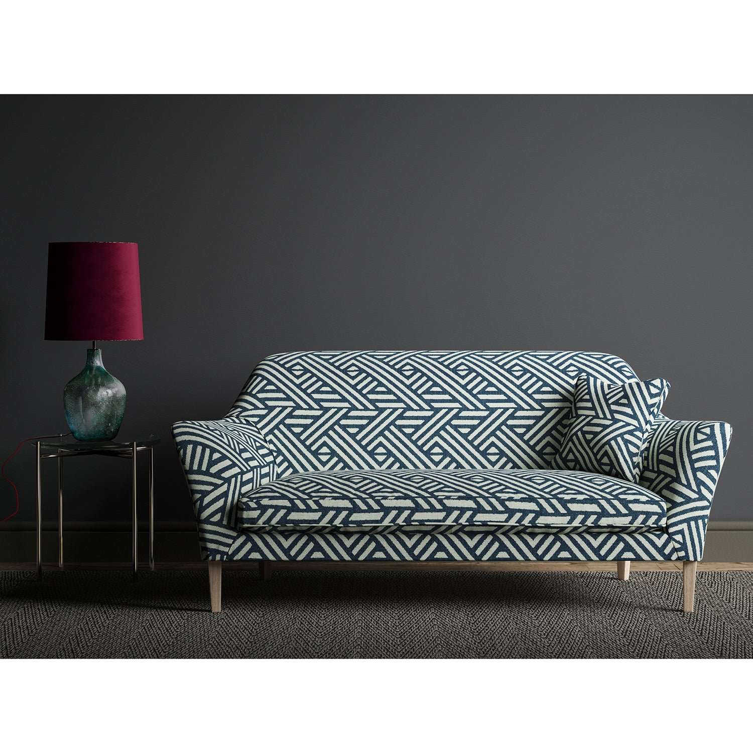 Sofa upholstered in a blue and white large scale geometric print