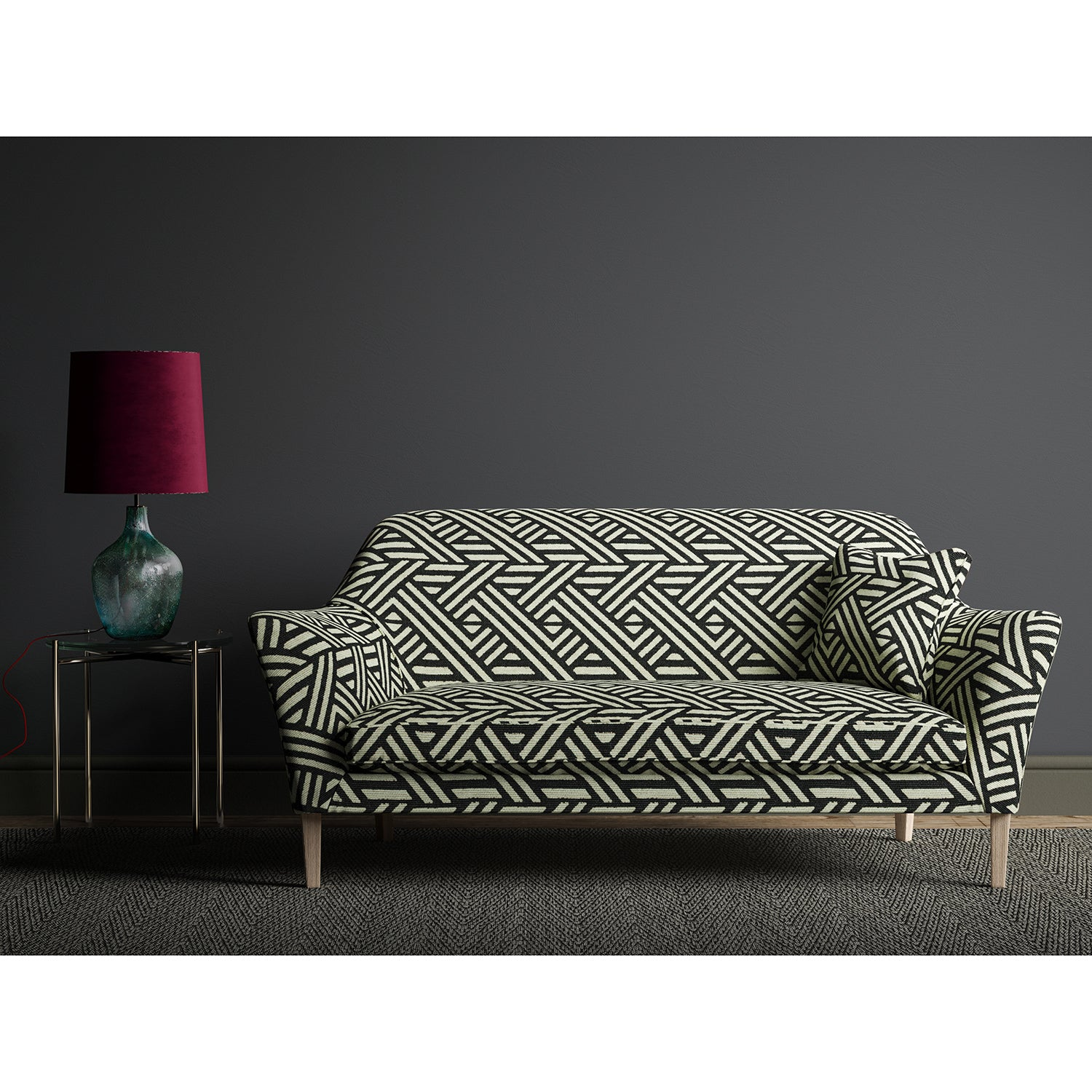 Sofa upholstered in a black and white geometric print