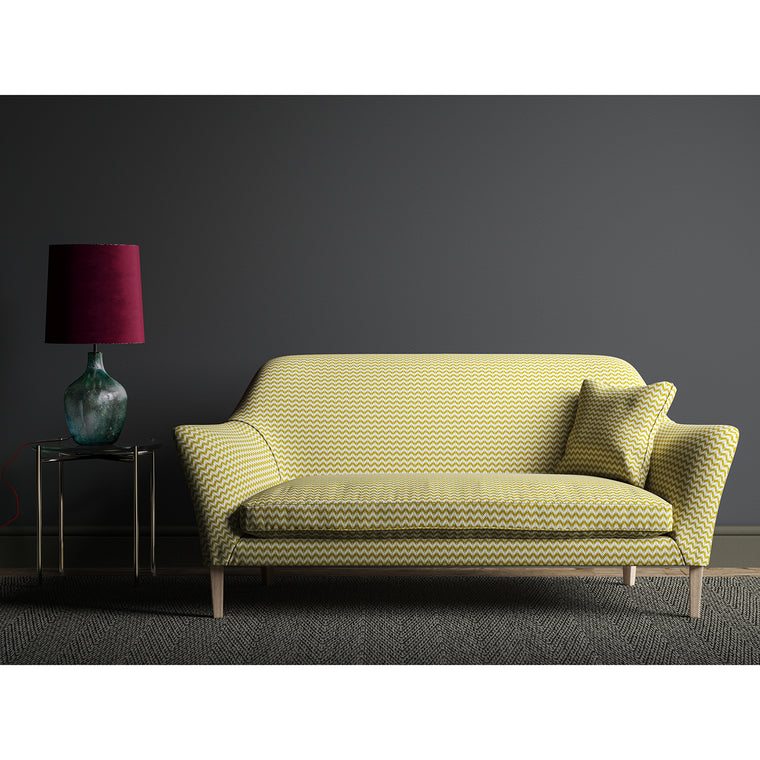 Sofa upholstered in a small scale geometric weave with yellow and neutral colours