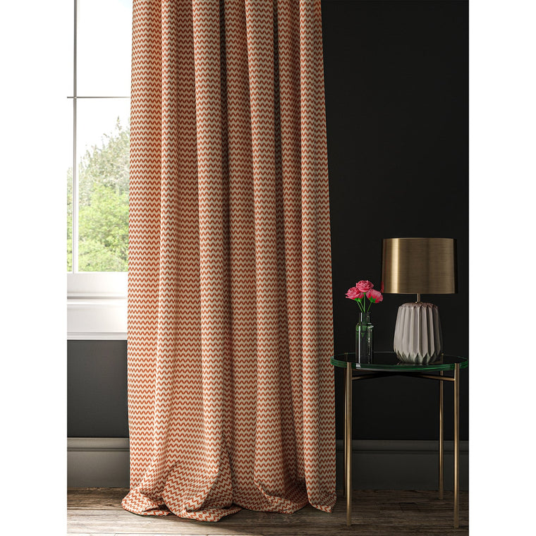 Curtain in a orange and off white geometric weave fabric