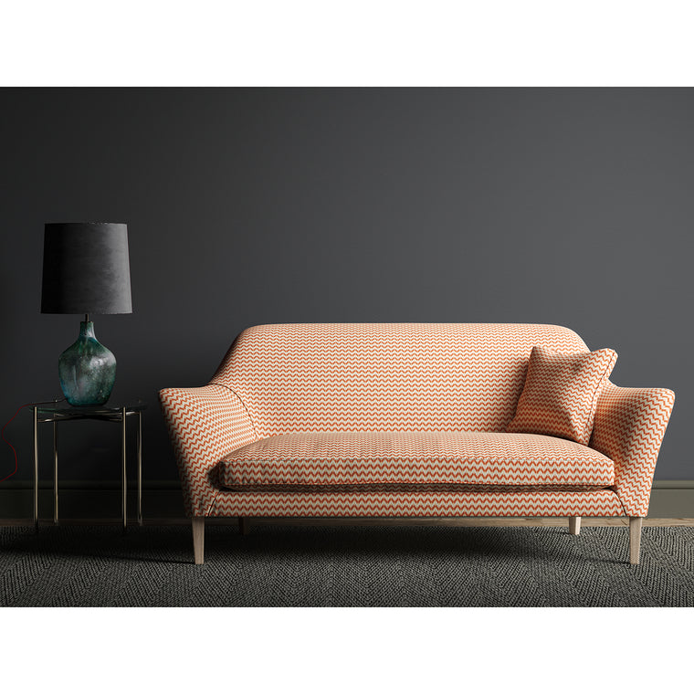 Sofa upholstered in a small scale orange and off white geometric weave