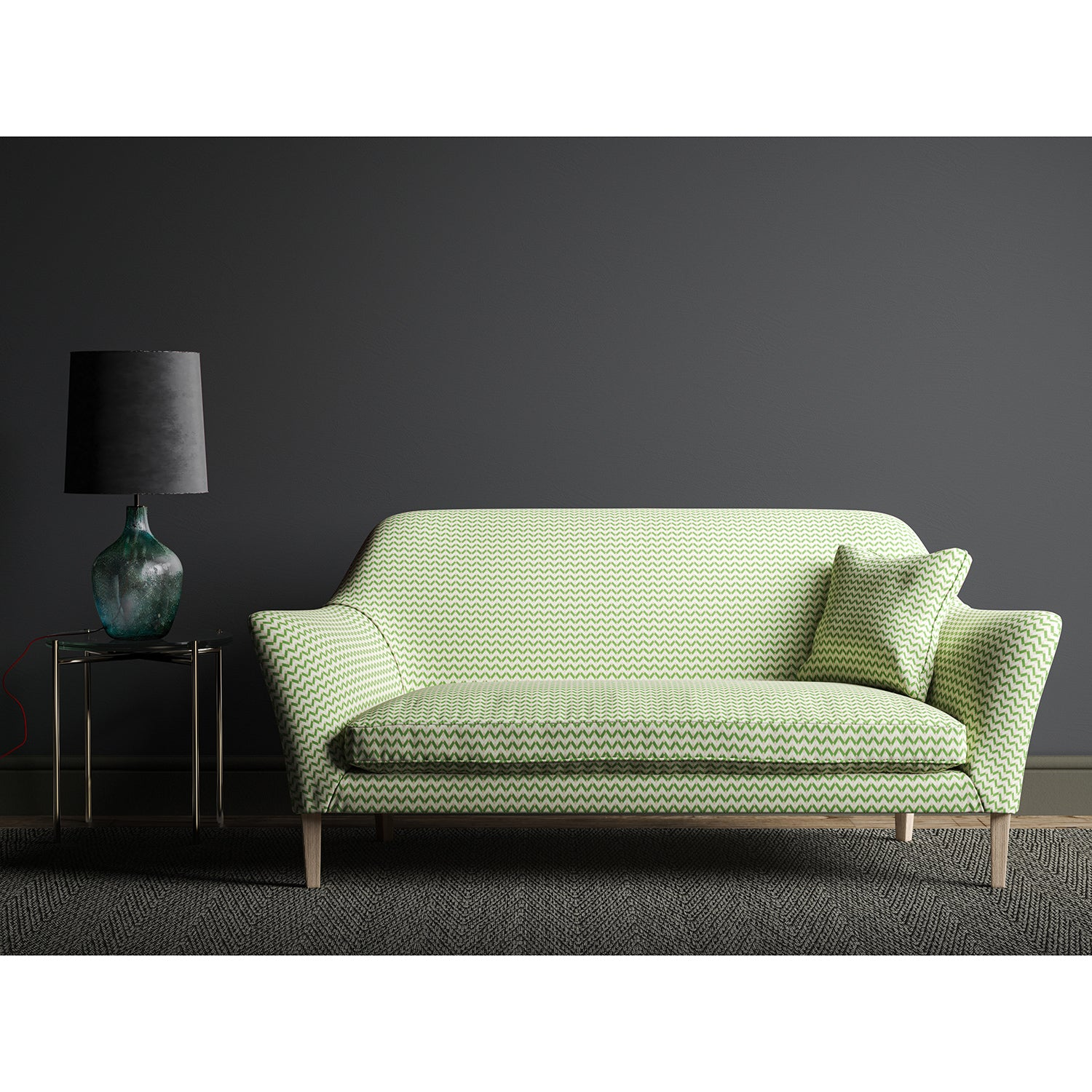 Sofa upholstered in a small scale green, pink and cream geometric weave